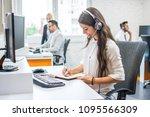 smiling woman operator agent... | Shutterstock . vector #1095566309