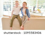 warm and cozy portrait of two... | Shutterstock . vector #1095583406