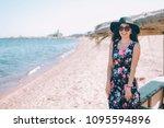 a girl in a hat  a long dress... | Shutterstock . vector #1095594896