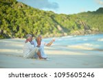 happy elderly couple resting | Shutterstock . vector #1095605246