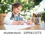 Child girl drawing picture...