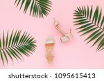 pink heeled sandal and tropical ...   Shutterstock . vector #1095615413