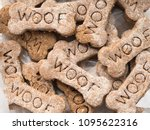 Stock photo close up view of home made dog treats with the word woof 1095622316