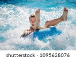 funny girl taking a fast water... | Shutterstock . vector #1095628076