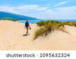 young woman tourist with... | Shutterstock . vector #1095632324