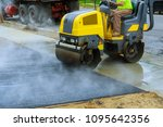asphalting construction works... | Shutterstock . vector #1095642356