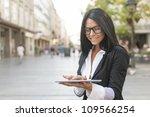 beautiful woman using tablet... | Shutterstock . vector #109566254