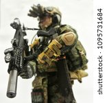 Small photo of KUALA LUMPUR, MALAYSIA -MAY 3, 2018: Selected focused of modern army action figure complete with uniform, battle gear and weapon. Collector item action figure with very high detail.