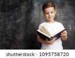 smiling schoolboy standing near ... | Shutterstock . vector #1095758720