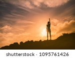 woman standing on a mountain... | Shutterstock . vector #1095761426