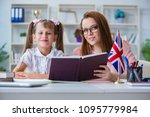 young girl learning english... | Shutterstock . vector #1095779984