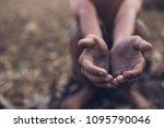 selective focus. hands poor...   Shutterstock . vector #1095790046