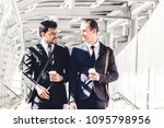two smiling businessmen talking ... | Shutterstock . vector #1095798956