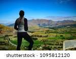 woman looking out from mountain   Shutterstock . vector #1095812120