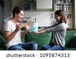 smiling girl giving gift box to ... | Shutterstock . vector #1095874313