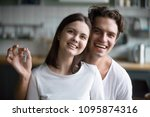 Small photo of Excited millennial couple holding keys embracing looking at camera in new home, smiling customers, tenants or renters happy to buy rent real estate, property ownership concept, headshot portrait