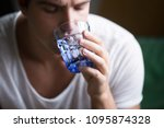 young man feeling thirsty... | Shutterstock . vector #1095874328