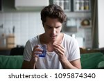 millennial man taking... | Shutterstock . vector #1095874340