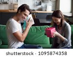 excited millennial couple... | Shutterstock . vector #1095874358