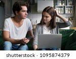 angry husband holding credit... | Shutterstock . vector #1095874379