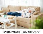 elderly woman falling asleep on ... | Shutterstock . vector #1095892970