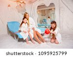 mother with two children in... | Shutterstock . vector #1095925799