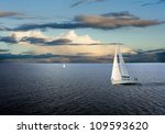 Sail Boats On Sea With Cloudy...