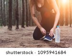 woman tying up shoelaces when... | Shutterstock . vector #1095941684
