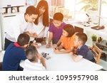 cheerful male teacher...   Shutterstock . vector #1095957908