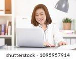 asian woman using laptop ...   Shutterstock . vector #1095957914