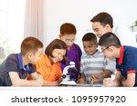 cheerful male teacher...   Shutterstock . vector #1095957920
