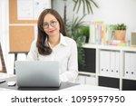 asian woman using laptop ...   Shutterstock . vector #1095957950