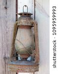 vintage kerosene lamp on wooden ... | Shutterstock . vector #1095959993