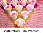 pink muffin with icing sugar | Shutterstock . vector #1095964028