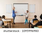 schoolgirl near the board with... | Shutterstock . vector #1095996983