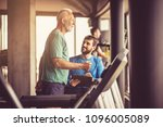 personal trainer giving support ... | Shutterstock . vector #1096005089