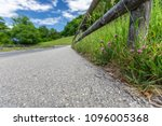 the road is in the mountains in ... | Shutterstock . vector #1096005368