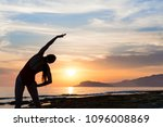 young girl practicing yoga on... | Shutterstock . vector #1096008869