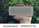 wireless speaker in hand with... | Shutterstock . vector #1096014716