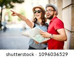 young couple looking at map and ... | Shutterstock . vector #1096036529