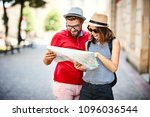smiling young couple lookin at... | Shutterstock . vector #1096036544