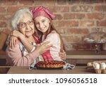 granddaughter hug her happy... | Shutterstock . vector #1096056518