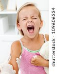 Distressed little girl getting an injection or vaccine - shouting hysterical - stock photo