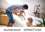father washing two toddlers in... | Shutterstock . vector #1096071260