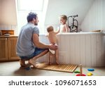 father washing two toddlers in... | Shutterstock . vector #1096071653