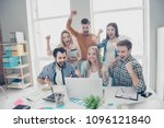 Stock photo cheerful glad joyful lucky stylish positive attractive business people looking at screen of 1096121840