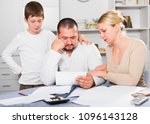 chagrined man sitting at home... | Shutterstock . vector #1096143128