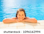 kid swims in the pool. smiling... | Shutterstock . vector #1096162994