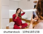 relaxed girl eating pizza while ... | Shutterstock . vector #1096185158