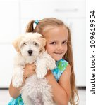 I got a little doggy - happy little girl hugging her pet - stock photo